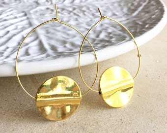 Gold plated hoop earrings with gold plated brass metal circle ornament