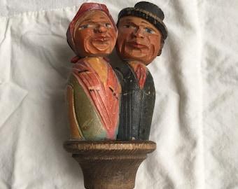 Vintage kissing carved bottle topper  hand carved moving kissing couple  cork  Anri carved cork