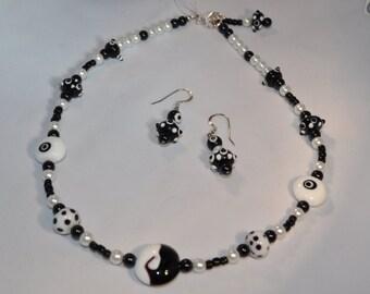 Black, White lampwork necklace/earring set