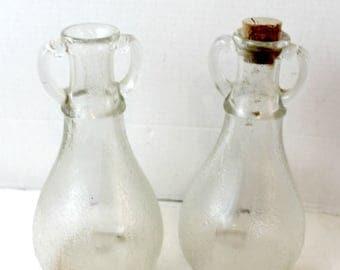 vintage glass bottles handled with cork textured