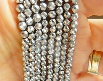 4 mm silver  hematite faceted  round beads FULL STRAND