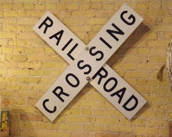 X pattern Railroad crossing sign, retired decommishioned train warning, reflecting