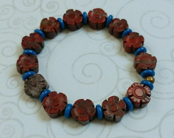 Brown Carved Flowers of Jasper With Blue Glass Accents Stretch Bracelet