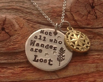 "Hand stamped ""Not all who wander are lost"" necklace with little compass charm."