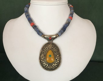 Tibetan amber pendant with blue sodalite and coral beads