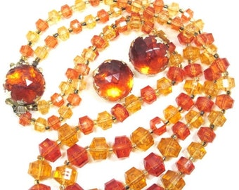 ON SALE 70's Signed Plastic Beaded Necklace and Earring Set.Foiled Back Faceted Orange Glowing Beads