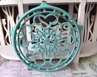 Antique art nouveau blue  cast iron trivet.