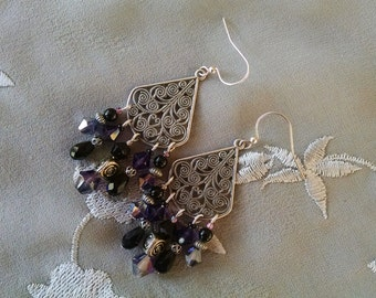 Silver chandelier earrings with purple and black Austrian crystals