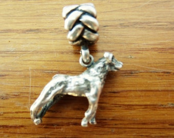 Small silver dog charm with slide bead.  Silver dog charming charm.