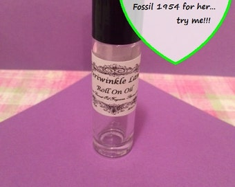 Fossil 1954 for her type roll on perfume oil
