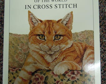 Cat needlework patterns:  Cats of the World in Cross Stitch 2002  and The Needlepoint Cat 1983  includes instructions for items to make