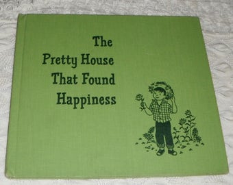 Vintage hardcover book The Pretty House That Found Happiness by Eleanor Eisenberg