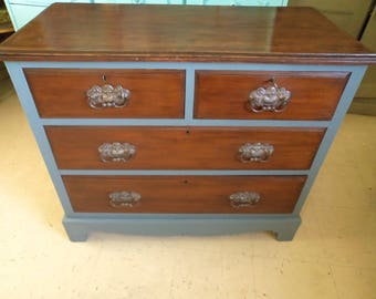 Chest of antique vintage mahogany drawers with hand painted frame in grey.