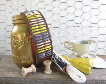 Vera cuff. Brown leather cuff woven with dark grey, sunshine yellow and dark ivory vintage Swistraw by Ruby Buffalo.