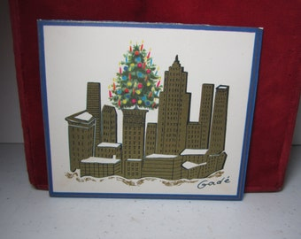Vintage 1950's-60's artist signed Gorde gold gilded christmas card city skyline colorful christmas tree on building,Ernest O. Manville