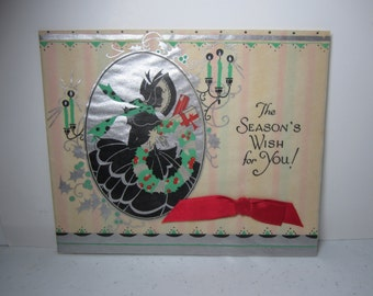 Gorgeous 1933 Designed By Davis art deco silver gilded parchment paper christmas card silhouette of victorian lady holds wreath and presents