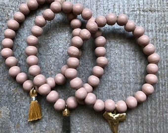 Set of three blush wood bead stretch bracelet set