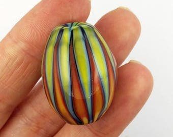 Circus lampwork focal glass bead in shades of green, yellow, coral and turquoise