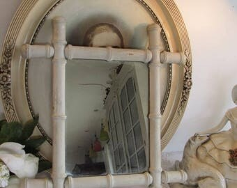 Antique French very chippy but very lovely old painted bamboo mirror.  Cottage chic..