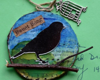 Bird Christmas, holiday, ornament, birch wood slice, round, wall art on wood, mirror, inks, branch, music, paper, blue and green