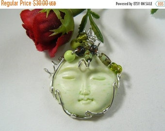 Large Lime colored Carved Moon face, Wire Wrapped Pendant using 14kgf wire (w51762)