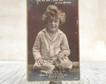 Vintage postcard of a little girl in pyjamas. Cute collectable silver photographic postcard, ephemera 1920s