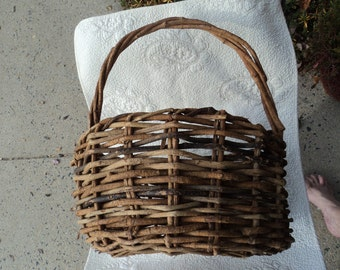Vintage gathering basket of woven willow that is large and sturdy and ready for veggies