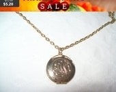 Goldtone locket necklace, locket pendant necklace