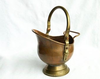 Small vintage copper coal bucket or scuttle with faces on the handle...copper planter.