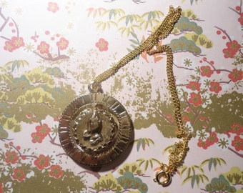 1 Goldplated 16 inch Necklace with Spinning Religious Medalion