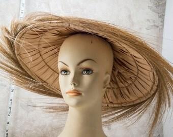 Asian rice paddy straw hat. Fringed, natural fibers. Sun hat, ethnic, China, Japan, Korea, Laos