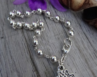 Sterling silver cross bracelet. Equilibrium cross.