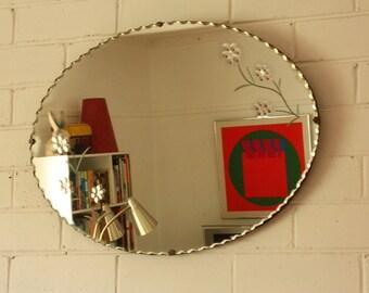 Oval Pie Crust Mirror with flower desgin