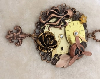 Steam Punk Pendant - copper with movable propeller and other charms