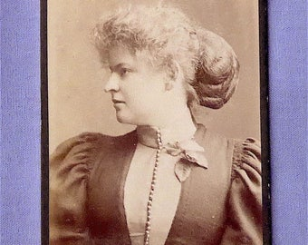 Carte-de-visite, antique.   Profile of a young lady, her long hair caught up in a hairnet. 'Barry', Anlaby Rd. Hull. c1890's.