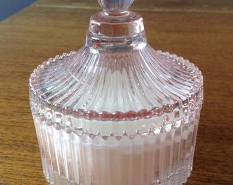 Pale pink glass lidded dish with handmade scented soy candle