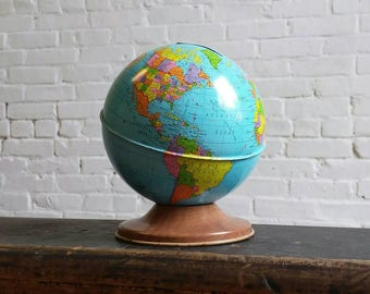 Vintage globe coin bank by Ohio Art world cashbox