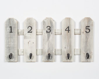 Barnwood Fence With Numbered Hooks Made From Reclaimed Wood