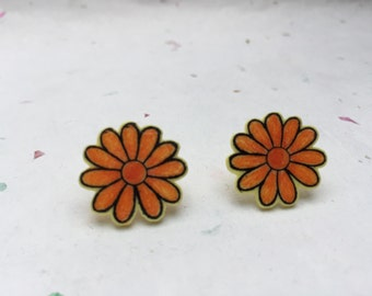 Orange daisy flower stud earrings in yellow shrink plastic