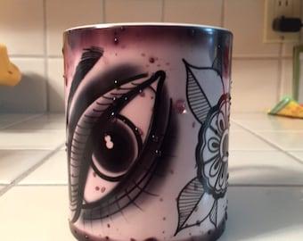 Heat activated tattoo design coffee mug