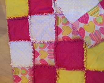 Beautiful rag quilt with minky and flannel.The print is a cute heart print in hot pink, yellow and white