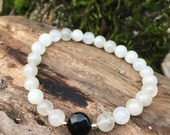 Black Onyx and moonstone mala bracelet by Bicycling Buddha YC23