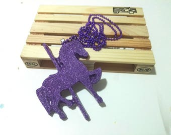 Necklace with purple resin pendant with carousel horse