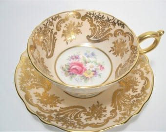 Double Warrant Paragon Tea cup And Saucer, Gold filligree on Beige teacup and saucer, Floral Teacup and Saucer.