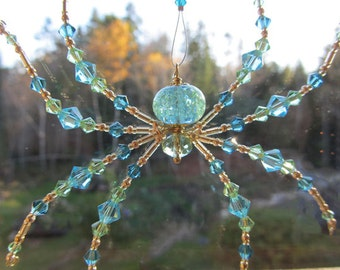 Beaded Spider Turquoise Ornament – Arachne the Weaver-Blues & Green Sun Catcher with Legend