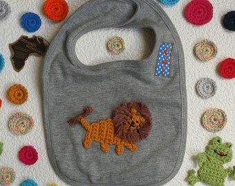 baby bib personalised with lion embroidery in grey or blue cotton with velcro-fastener, one size rikiki kids