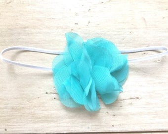 blue chiffon fabric flower attached to white stretch headband, hair bow