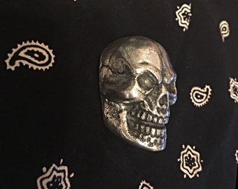 Aluminum sand cast skull.