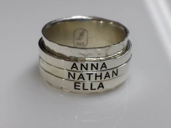 Spinner ring. Sterling silver main ring with 3 custom engraved spinners. Completely customized, personalized, and unique.