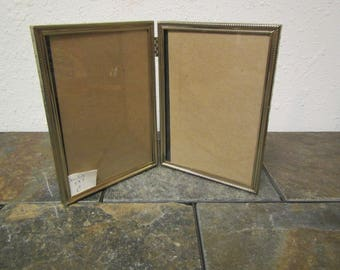 vintage    Double hinged 5 by 7 Gold tone finish  picture frames with clear glass , free standing photo frames double 5x7 C